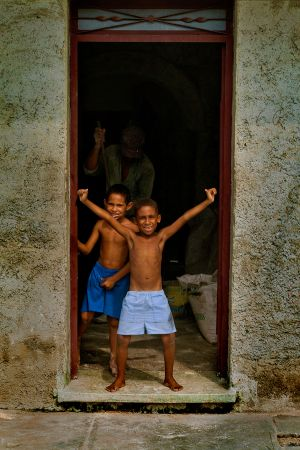 2 BOYS PLAYING IN THE DOORWAY