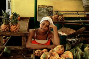 YOUNG WOMAN FRUIT VENDER