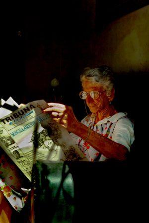 LADY READING LA TRIBUNA DE LA HABANA IN HER HOME