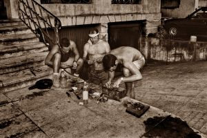 MEN WORKING ON CAR PARTS