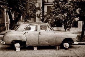 OLD CAR ON BLOCKS