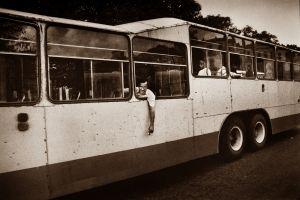 MAN RIDDING ON CAMELBACK BUS